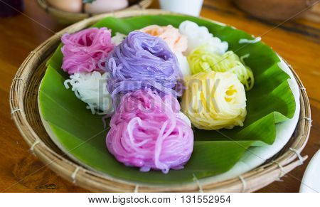 A Popular Menu Of Thai Food , Colorful Of Thai Vermicelli With Boiled Egg In Basket On Wood Table