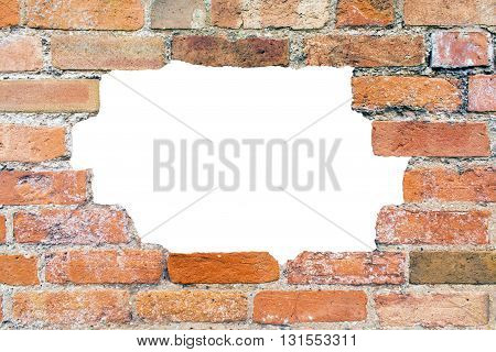 Hole in an old and aged brick wall texture with broken and damaged bricks on an isolated white background with copy space for a additional messages with a clipping path
