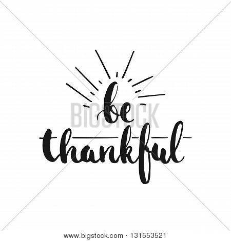 Be thankful - hand drawn lettering phrase isolated on the white background. Fun brush ink inscription for photo overlays typography greeting card or t-shirt print flyer poster design.
