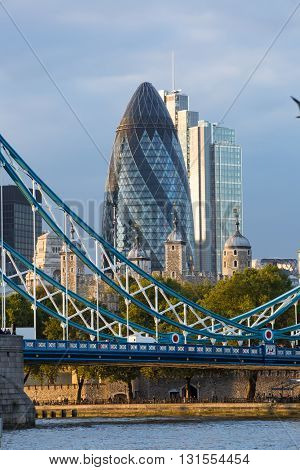 LONDON, UK - SEPTEMBER 19, 2015: Tower bridge and City of London at dusk and first night lights.  View includes Gherkin and other buildings at the background