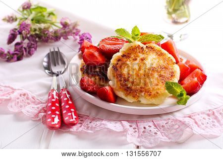 Sweet ricotta fritters with strawberry on plate
