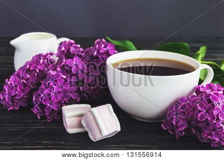 Cup Of Coffee, Marshmallow And Lilac Flowers