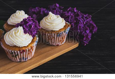 Homemade Sweet Cupcake With Cream And Flowers