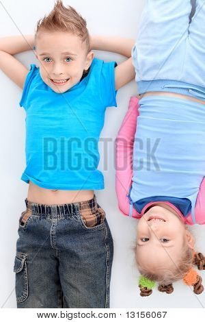Portrait of a cute children. Isolated over white background.
