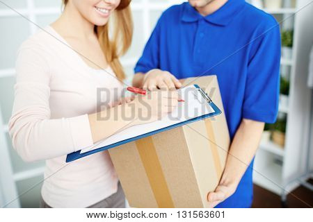 Woman signing receipt for delivered package
