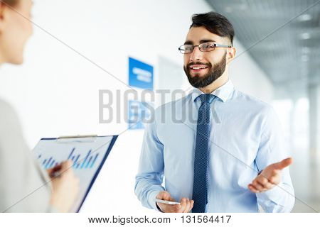 Businessman talking to his secretary