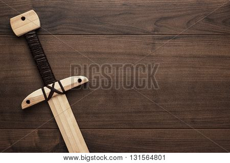 handmade wooden training toy sword on the table