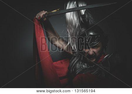 Spartan, Praetorian Roman legionary and red cloak, armor and sword in war attitude