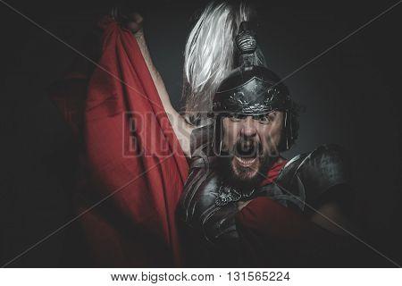 Culture, Praetorian Roman legionary and red cloak, armor and sword in war attitude