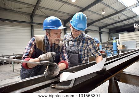 Engineers working on project in metallurgy manufacture