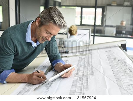 Architect working on project in office