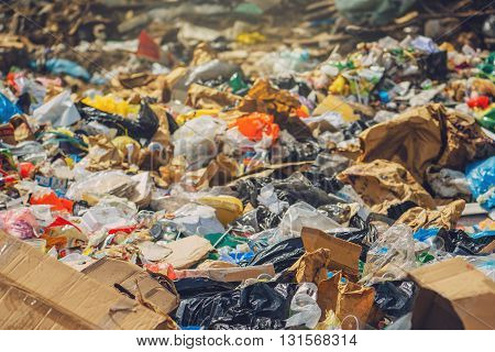 Garbage dump various trash and waste material environmental pollution and ecology concept selective focus