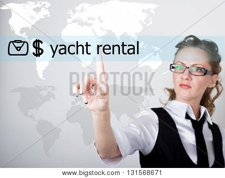 yacht rental written on a virtual screen. Internet technologies in business and tourism. woman in business suit and tie, presses a finger on a virtual screen.