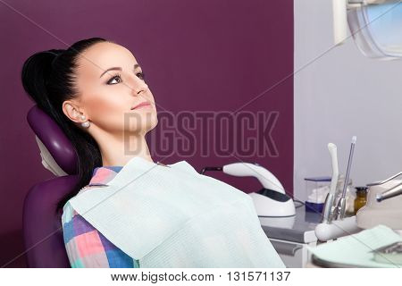 Young Woman Patient Waiting For Dentist Ready For Check-up
