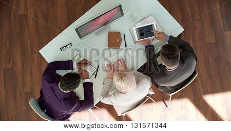 High angle view of managers working over data