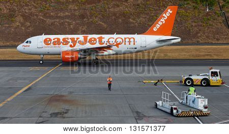 FUNCHAL, MADEIRA - JULY 10, 2011: The easyjet plane on the runway
