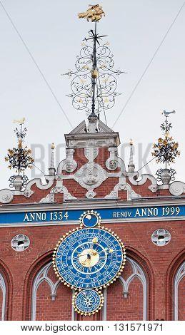 RIGA, LATVIA - JANUARY 07, 2012: The clock on the facade of the House of Blackheads in Riga