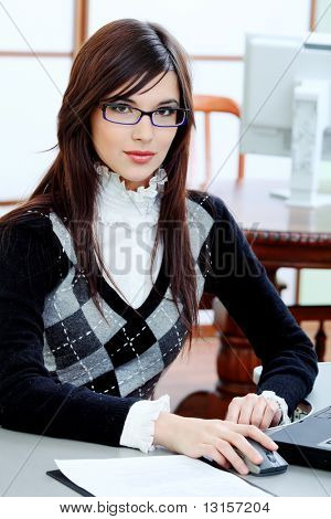 Business theme: beautiful businesswoman working at the office.