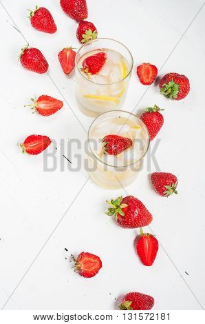 homemade lemonade on a white wood background.