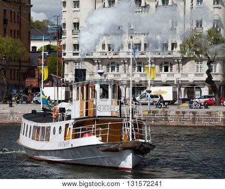 STOCKHOLM, SWEDEN - MAY 18, 2012: Frithiof - vintage touristic steamer in waters of Stockholm