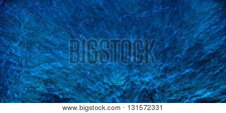 Blue water with shadows and glare. Background