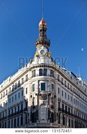 MADRID, SPAIN - JANUARY 04, 2013: Credit bank of Spain in Madrid and the moon in the afternoon