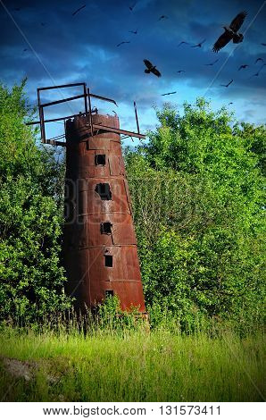 mysticism old rusty water tower with crows