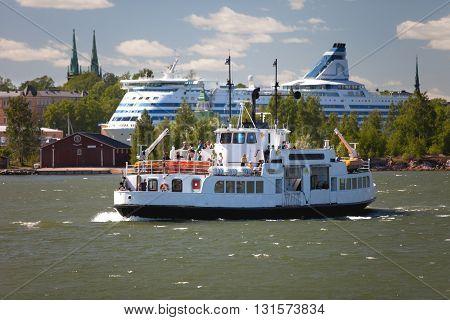 FINLAND, HELSINKI - JUNE 15, 2011: Small ferry from Helsinki to Suomenlinna fortress