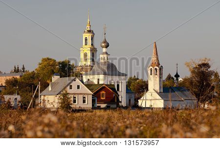 RUSSIA, SUZDAL - SEPTEMBER 21, 2104: View of the churches of the Epiphany of the Lord and the Nativity of John the Baptist from Ilyinsky meadow in ancient russian city Suzdal
