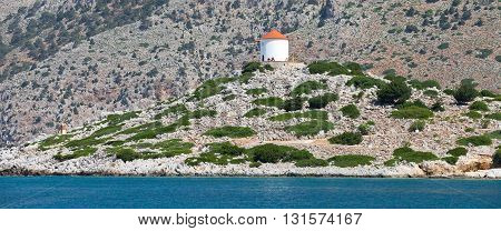 Windmill at the entrance to the harbour of Panormitis monastery