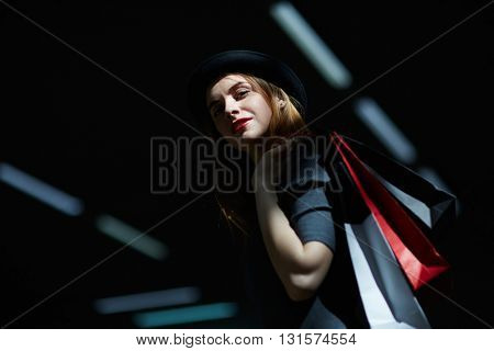 Portrait of fashionable woman with shopping bags
