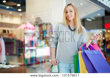 Portrait of young smiling woman in store