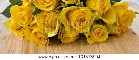 Mothers day greeting card, roses over wooden table.