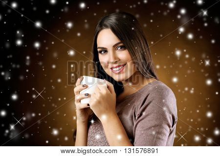 Pretty woman and cup of coffee with snow effect