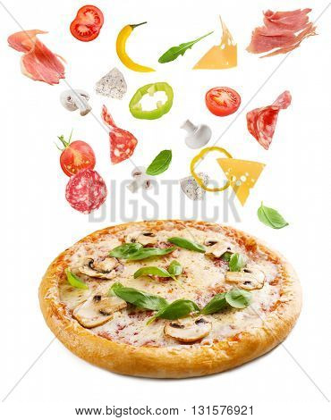 Tasty pizza with falling vegetables, pieces of salami and jamon, isolated on white