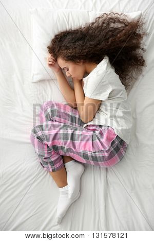 Beautiful girl sleeping in bed