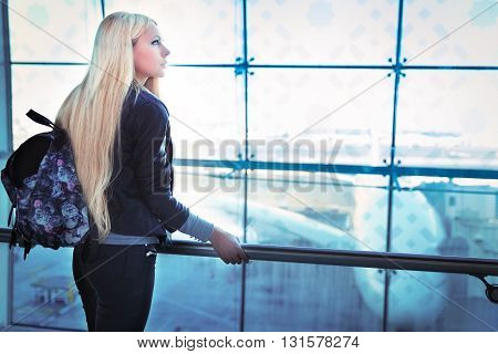 Young Pretty Blonde Woman Looking Into Window Airport