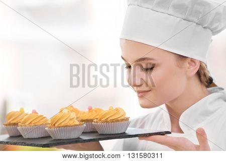 Female chef working at kitchen
