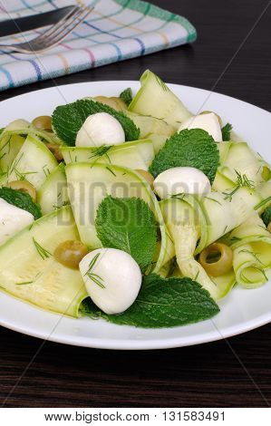 Zucchini salad with mozzarella olives dill and mint