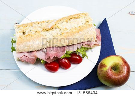 Ham baguette Half a French baguette stuffed with ham and lettuce as a snack