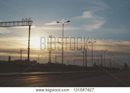 Blurred image of railway by early morning. Cargo transportation industry concept