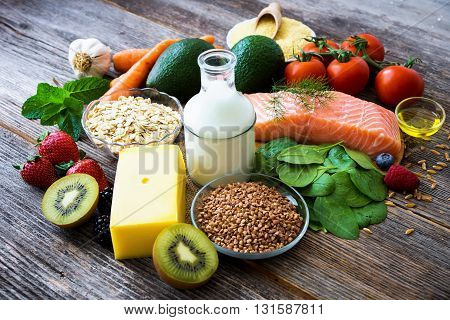 Selection Of Healthy Food On Rustic Wood Background