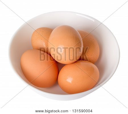 Eggs of chicken in a plate on a white background