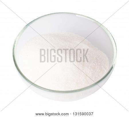 Granulated sugar in a bowl on a white background
