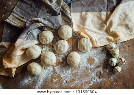 Preparing buns bread. Rustic style. Ingredients for homemade bread on wooden background. Bread cooking process. kneading dough on wooden plate bun cooking