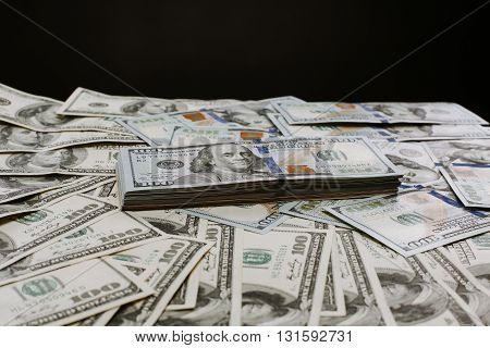 Close-up portrait photo of money. 100 dollars banknotes heap