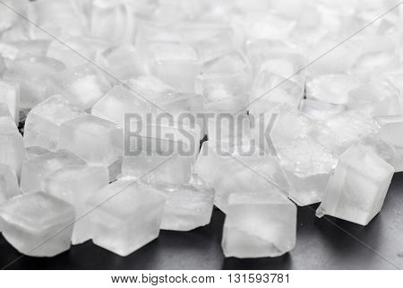 pile of different ice cubes on black background