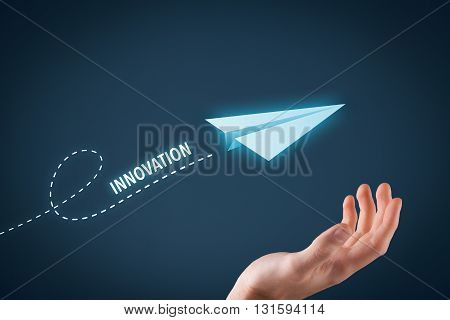 Innovation concept. Paper plane representing dreaming about innovations and hand touching this dream comes true.