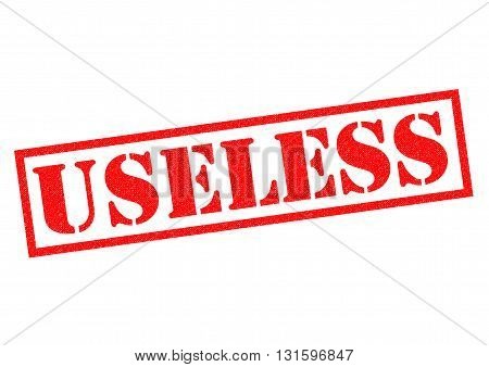 USELESS red Rubber Stamp over a white background.