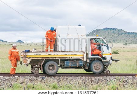 MIDDELBURG SOUTH AFRICA - MARCH 8 2016: Unidentified railroad maintenance workers with a truck modified to drive on railroad tracks